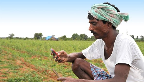 Farmer using mobile banking services