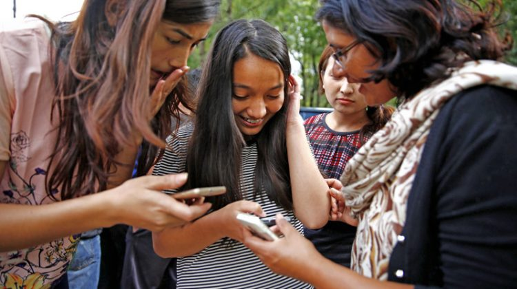 Girl using mobilephones in Nepal