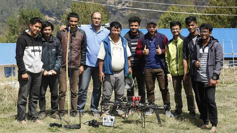 A team of Nepali engineers pose for a picture along with the medical drone used to supply medicines in remote villages in Myagdi, Nepal April 9, 2018.