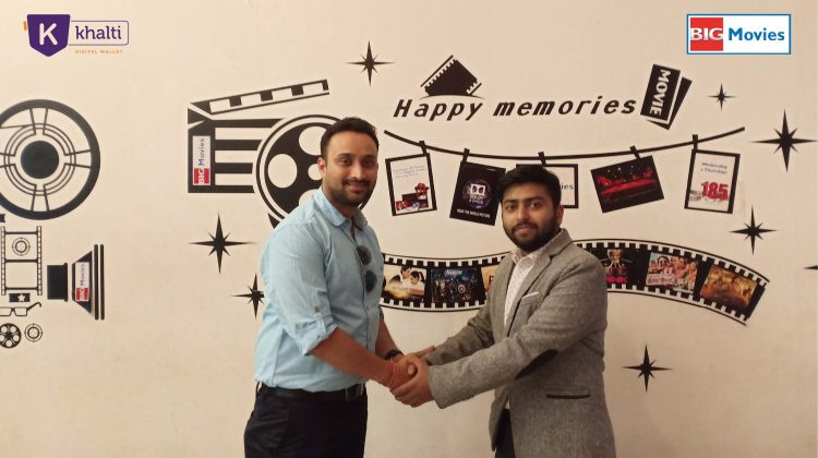 Amit Agrawal (L), Director of Khalti, and Bharat Agrawal, CEO of Cinestar Pvt. Ltd. (Big Movies) shake hands after signing partnership agreement